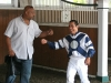 Trainer Tony Wilson give Paco a congrats for his 1000