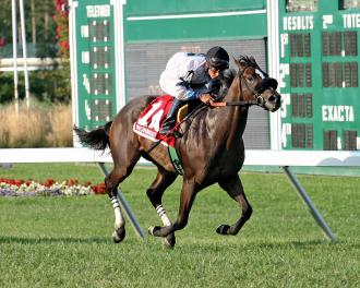 Flay Mignon and jockey Paco Lopez win the Colleen Stakes by 1 3/4 lengths Sunday.