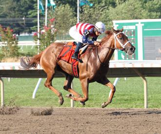 Seaneen Girl, with Paco Lopez riding, picks up her second graded victory by winning the Monmouth Oaks.