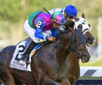 Itsmyluckyday, ridden by Paco Lopez, overtakes Moreno in deep stretch of the Woodward Stakes