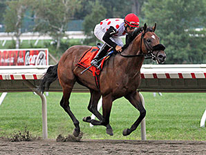 Paco wins the Sapling Stakes with Souper Colossal